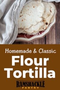 """Homemade & Classic Flour Tortilla with a plate containing a pile of the Mexican recipe"