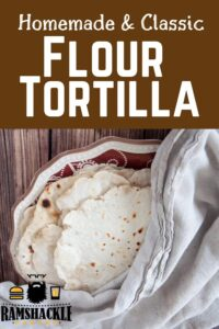 """Homemade & Classic Flour Tortilla"" on a plate and covered with a towel"