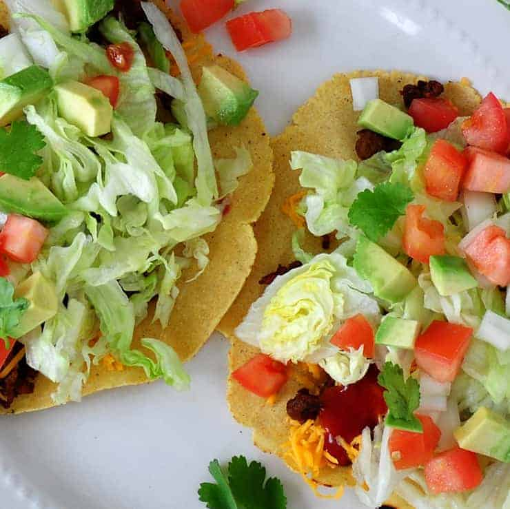 Two Tacos with homemade, fresh tortillas on a white plate