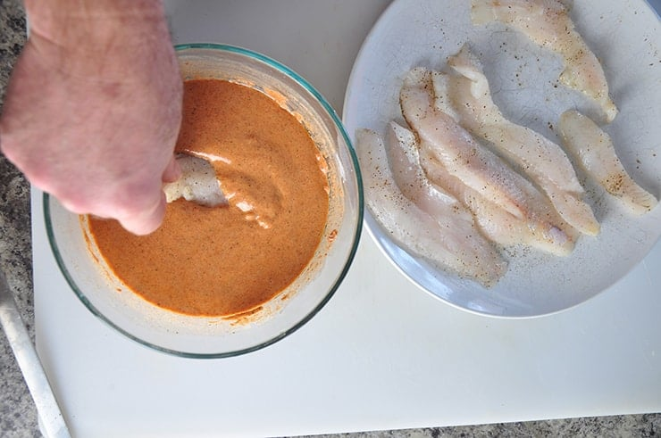 Dipping Fish into beer batter