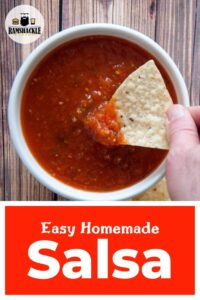 """""""Easy Homemade Salsa"""" with one chip being dunked into a white bowl filled with salsa."""