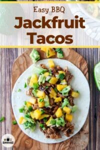 """An image of a Jackfruit Taco on a wood cutting board and the text """"Easy BBQ Jackfruit Tacos"""""""