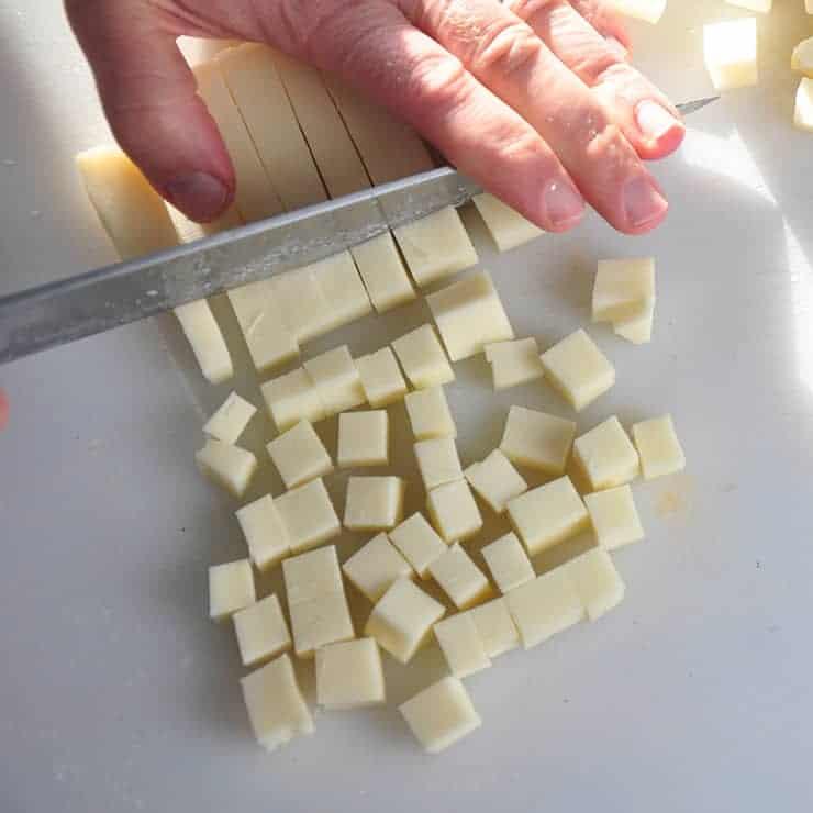 Cutting Mozzarella Cheese into cubes