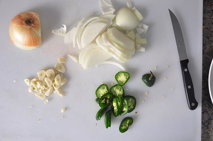 Some of the ingredients on a cutting board just waiting to be added to our homemade salsa