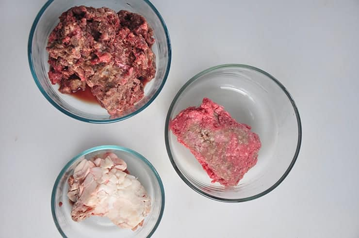 Overhead picture of heart meat, ground chuck, and beef suet.
