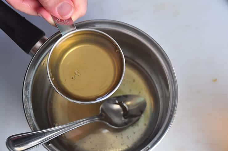 Pouring Honey into Ginger water to make Ginger Syrup