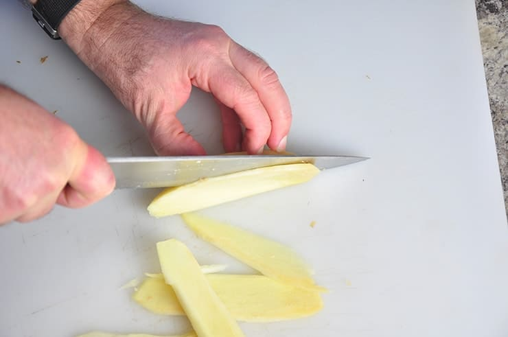 Slicing Ginger on a Cutting Board