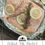 Grilled Foil Packet Salmon on tinfoil and a baking sheet with some asparagus to the side.