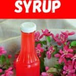 """Rhubarb Syrup"" with a picture of a bottle of the recipe on a table with pink flowers"