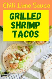 """Chili Lime Sauce - Grilled Shrimp Tacos"" on a platter with a striped placemat"