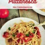 Classic Italian Seafood Puttanesca on a white plate