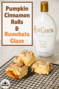 This Homemade Pumpkin Cinnamon Roll Recipe on a rack with rumchata in the background.