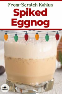 From-Scratch Kahlua Spiked Eggnog with a picture of the drink and ornamental Christmas lights.