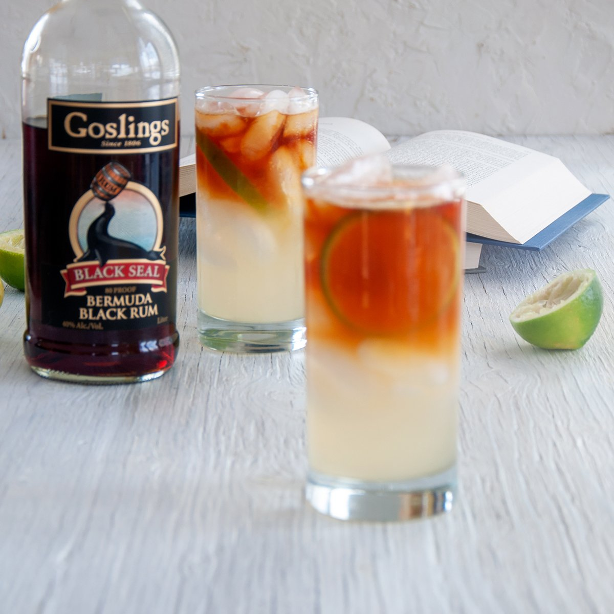 Two Dark 'n Stormy Cocktails with some Goslings Dark Rum in the background