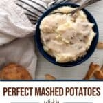 Bowl of make-ahead sous vide mashed potatoes on a white table with text overlay of the title.