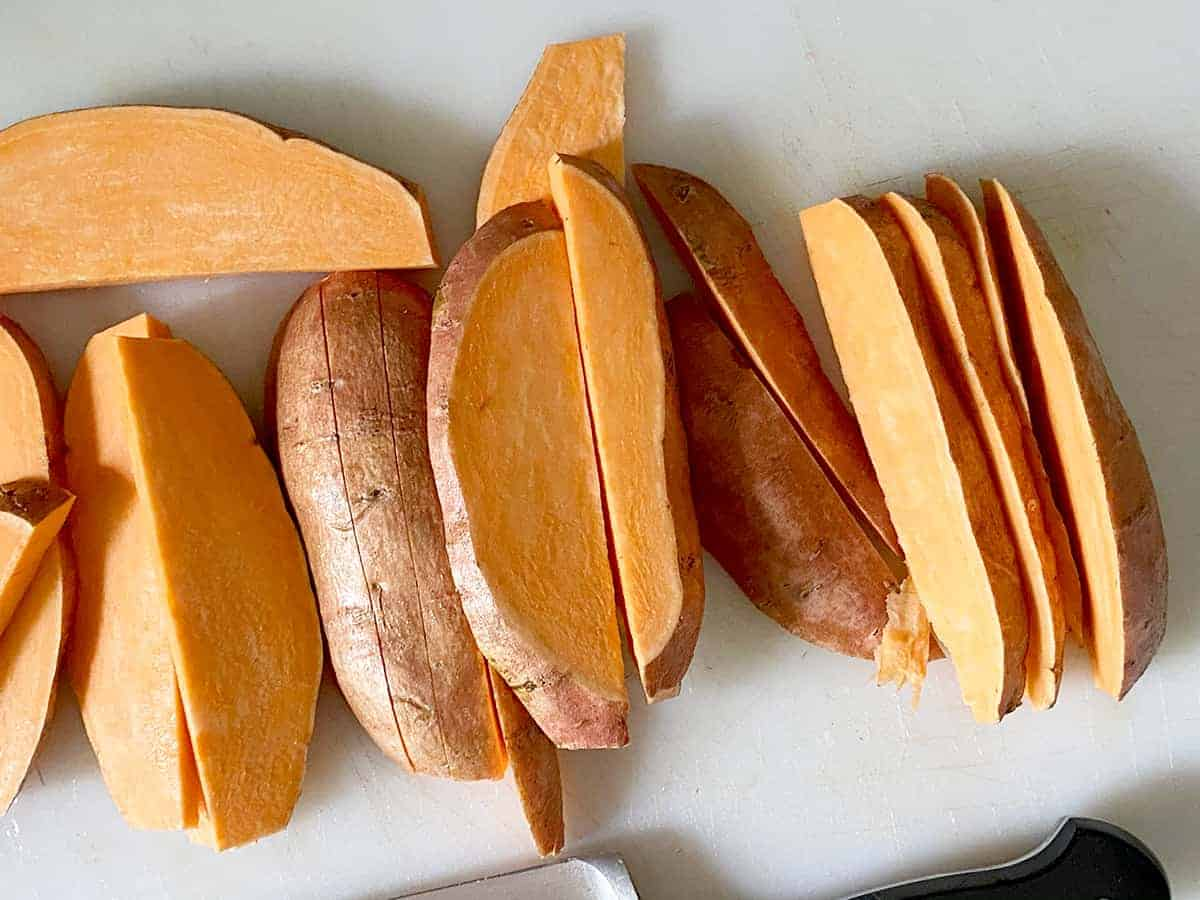 Process Picture depicting the cut sweet potato fries and demonstrating the width to cut to, about ½ inch.