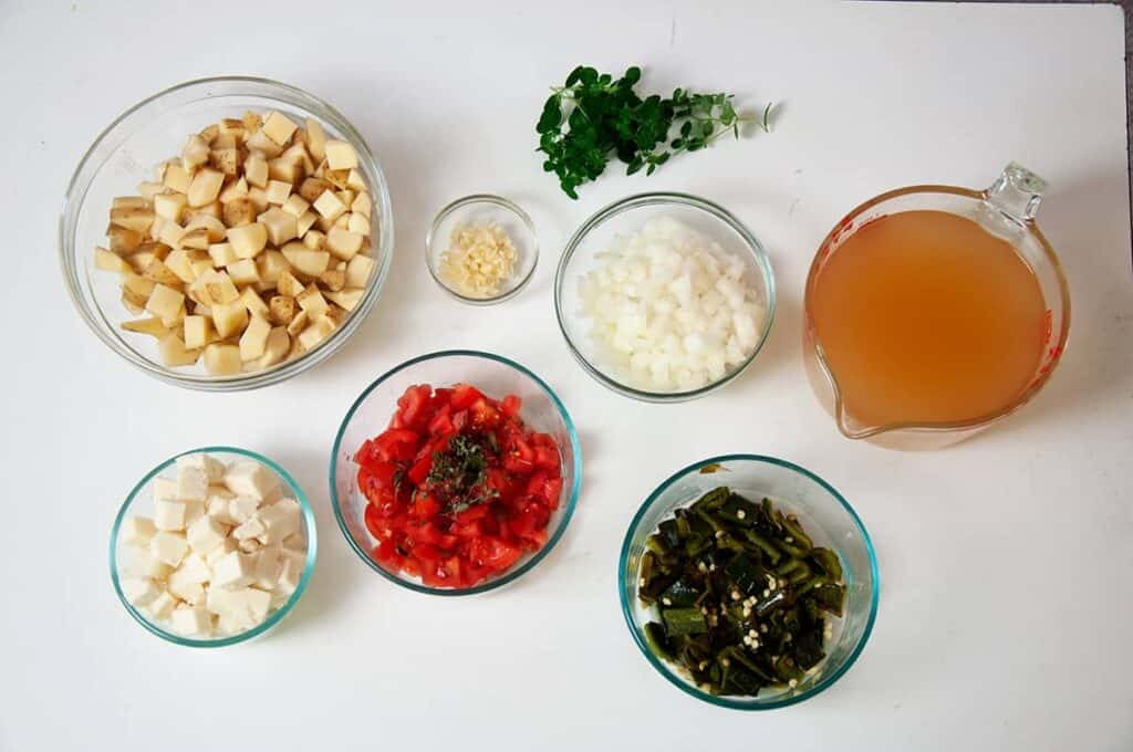 Many of the Ingredients for this soup including Queso Fresco, tomato, oregano, roasted poblano peppers, and chicken broth.
