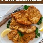 Easy German Pork Schnitzel with 4 cutlets on a plate.