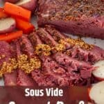 Sous Vide Corned Beef on a plate with potatoes and carrots.