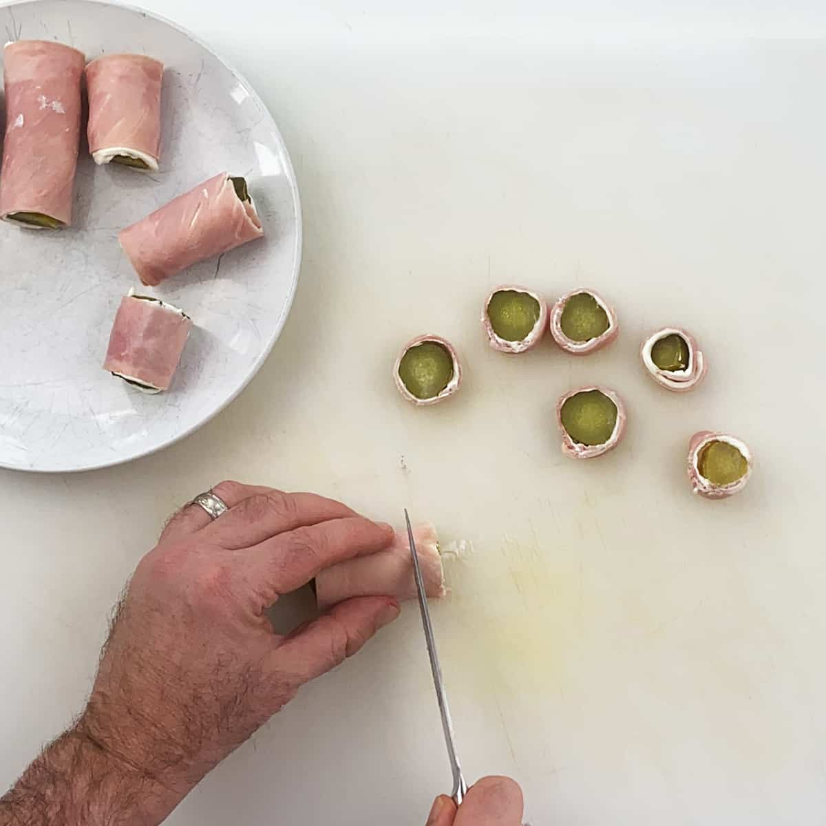 Cutting a pickle into individual pieces.