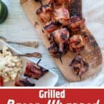 """Bacon Wrapped Shrimp Skewers on a wood cutting board with the text overlay """"Grilled Bacon Wrapped Shrimp"""""""