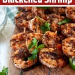 Grilled Blackened Shrimp on a wood cutting board.