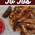 Grilled Jo Jos on a white mat and a side dish of ketchup.