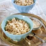Bowl of Spaetzle with parmesan cheese on top.